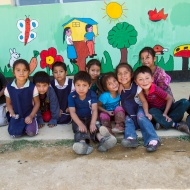 Children sit outside El Tunino school in Guatemala. El Tunino is one of nine schools in the Sumpango area where Rotary is improving water and sanitation facilities through Rotary global grant 25643. It now has clean water, new hand washing stations, toilets, septic tanks, and drainage systems.