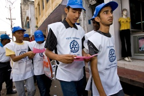 """Members of the local Interact club walk through Birgunj, Nepal, reviewing the map and schedule before they assemble immunization booths on a subnational polio immunization day. Border towns with little regulation like Birgunj create high risk of the spread of the poliovirus. Subnational immunization days target strategic locations based on research by Rotary's polio eradication partners, the World Health Organization, UNICEF, and the U.S. Centers for Disease Control. Find the story in """"The Rotarian,"""" December 2008, pages 28-43, and see Rotary Video Magazine 4.2."""