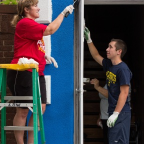 Kathy Kane (left), of the Rotary Club of Trenton, and her son, Interactor Dustin Kane, paint Irma Fuentes' hardware store in Detroit, Michigan, USA, 26 July 2014. Rotarians from Detroit area clubs donated money and labor to assist with these improvements. Fuentes is one of 13 participants in the inaugural LaunchDETROIT program. LaunchDETROIT, a project of Rotary District 6400, offers entrepreneurs and small business owners in the Detroit area free business training, microloans, business mentoring, and networking opportunities.